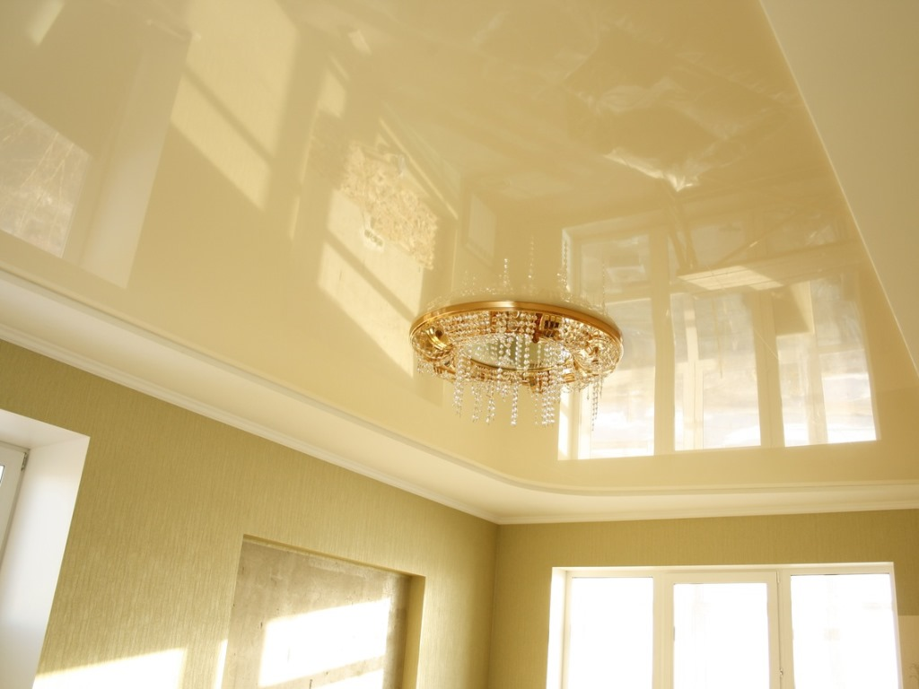 Glossy stretch ceiling design for a bright and large living room