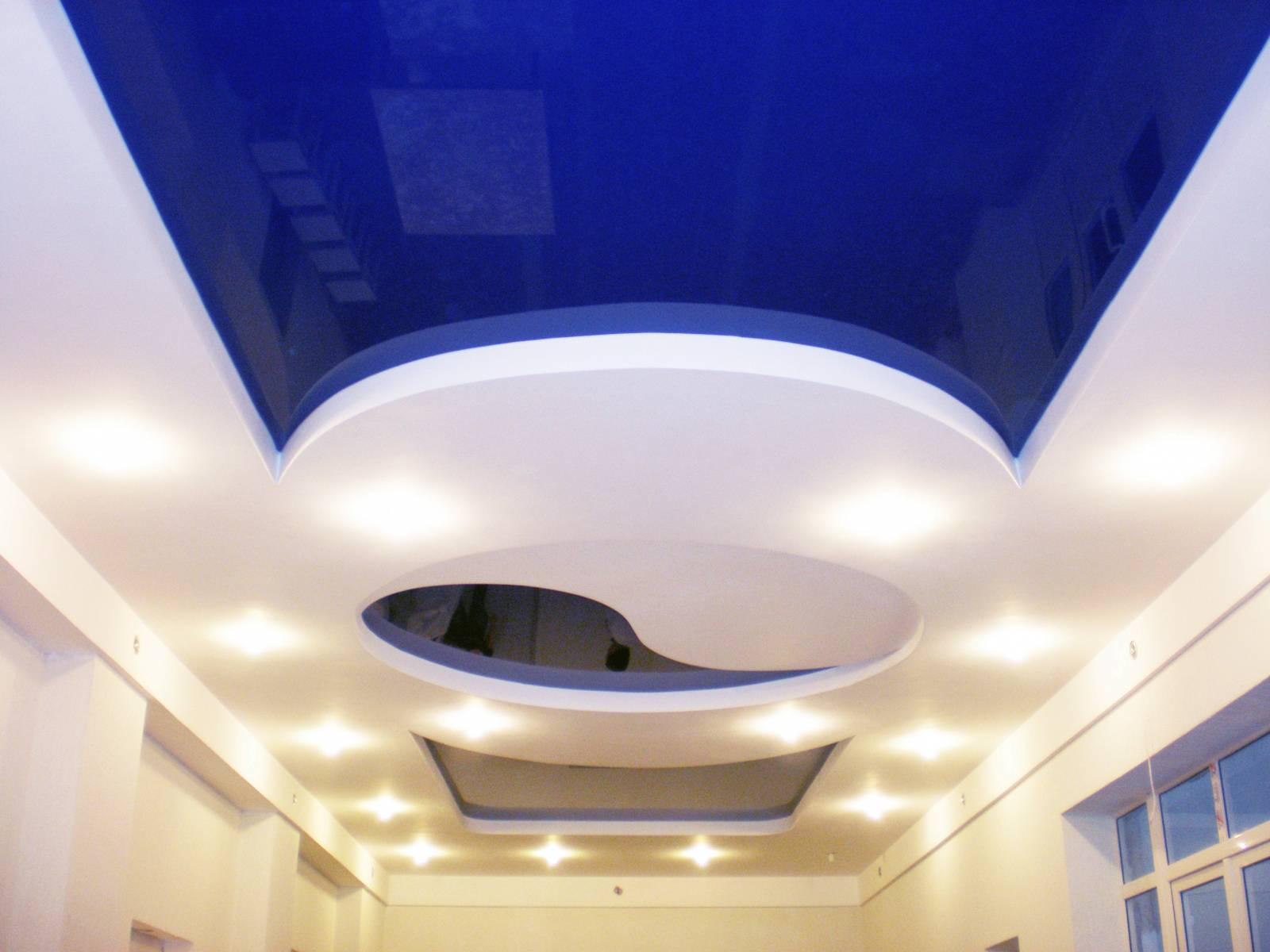 Living room interior with dark blue stretch ceiling