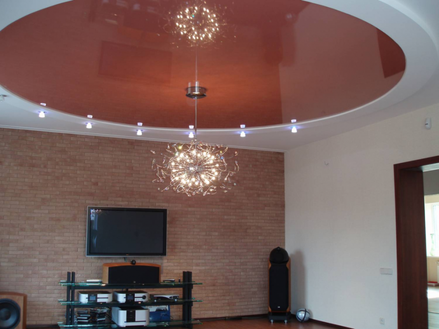 Stretch ceiling design in bright colors and unusual shapes for the living room