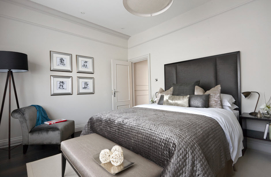 Bright walls in the bedroom with a dark gray bed