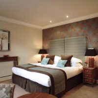 Cozy bedroom interior with dark furniture