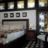 The contrast of white in the background of the black bedroom interior