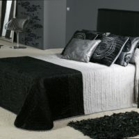 White floor in the bedroom with black furniture
