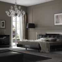 Gray painted walls in a room with a black bed