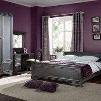 Dark lilac walls and gray bed