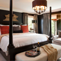 The combination of black, white and gray in the bedroom