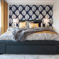 Black bed and light gray bedroom walls