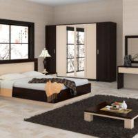 Low bed and dark rug on the bedroom floor