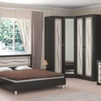 Bright bedroom interior with dark furniture