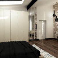 White walls and black bedspread