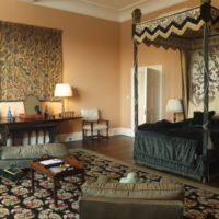 Oriental style bedroom with dark bed
