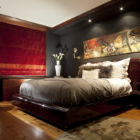 Bright curtains on the window in the bedroom with a dark interior