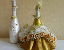 Robe riche sur une bouteille de champagne pour la mariée