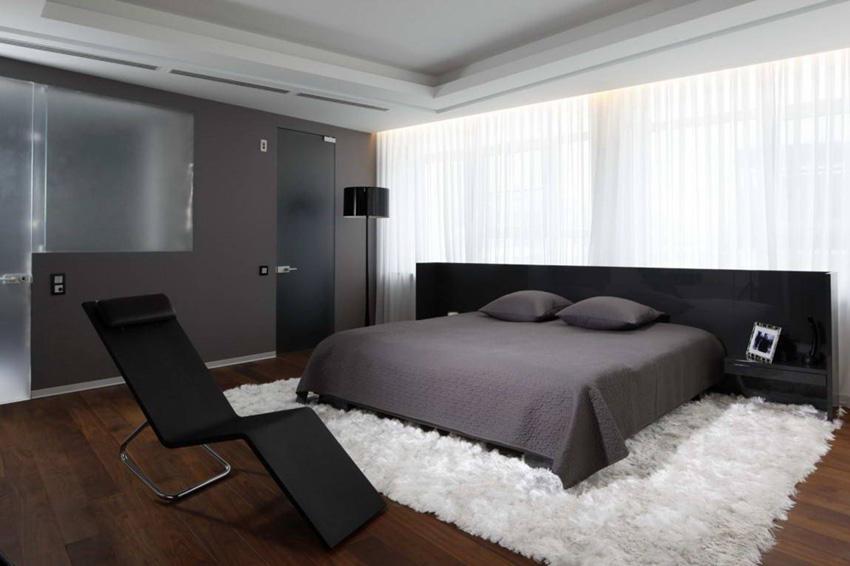 Bedroom with dark high-tech furniture