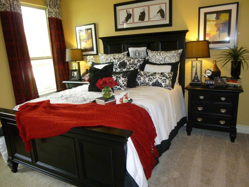Dark brown bed in the bedroom with yellow walls