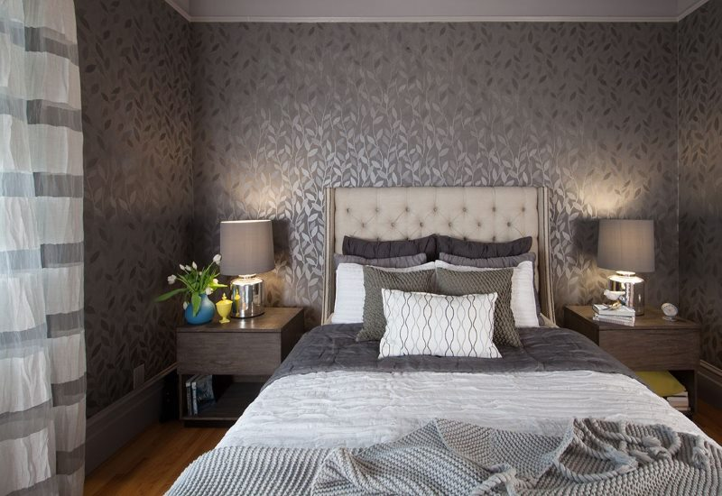 Dark gray wallpaper in the bedroom of a country house