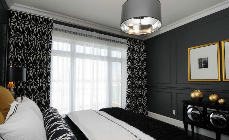 Yellow accents in the black bedroom