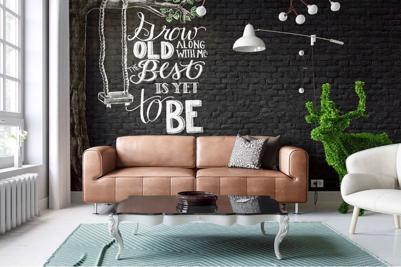 Brown sofa against a black wall with brickwork wallpaper