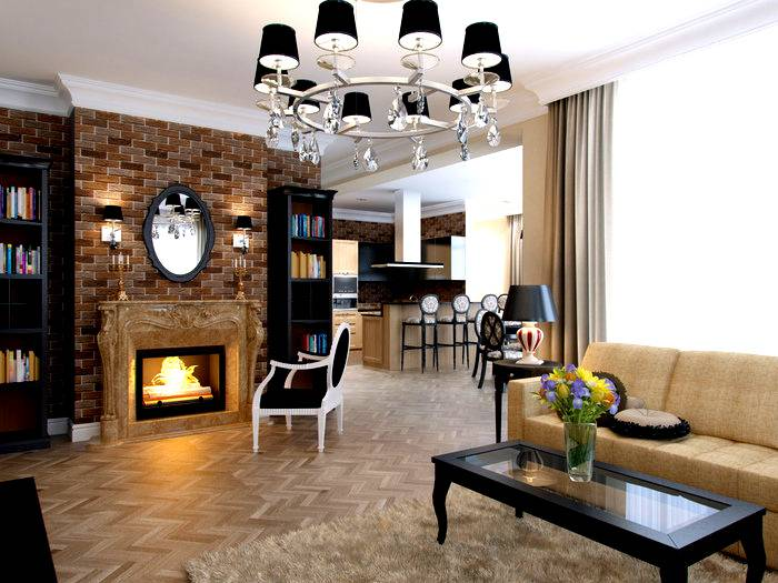 Chandelier with black shades on the ceiling of a modern living room