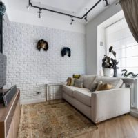 White brick wall in the interior of the living room of a city apartment