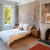 Brick wall decoration over the head of the bed