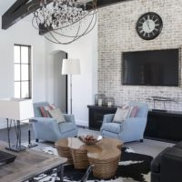 Black wood beams in a white living room