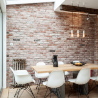 Brick wall decoration in the dining area of the kitchen