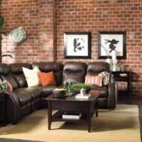 Leather furniture with black upholstery in the living room of a private house