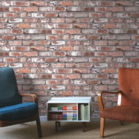 Retro armchairs on brick wall background