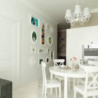 White kitchen living room with brick wall.