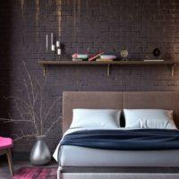 Raspberry armchair in the dark bedroom