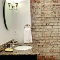 Wallpaper under the brick in the bathroom