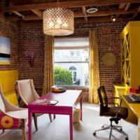 Yellow furniture on brick wall background