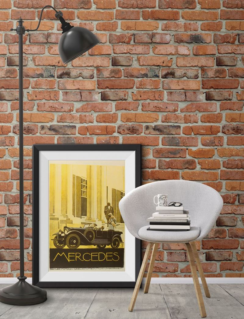Black floor lamp on a background of wallpaper with brickwork