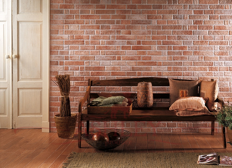 Wooden bench on a background of wallpaper under a red brick