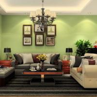 Melns paklājs viesistabā ar gaiši zaļām sienām