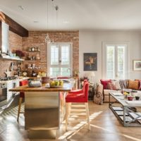 Cuisine de style loft avec meubles rembourrés