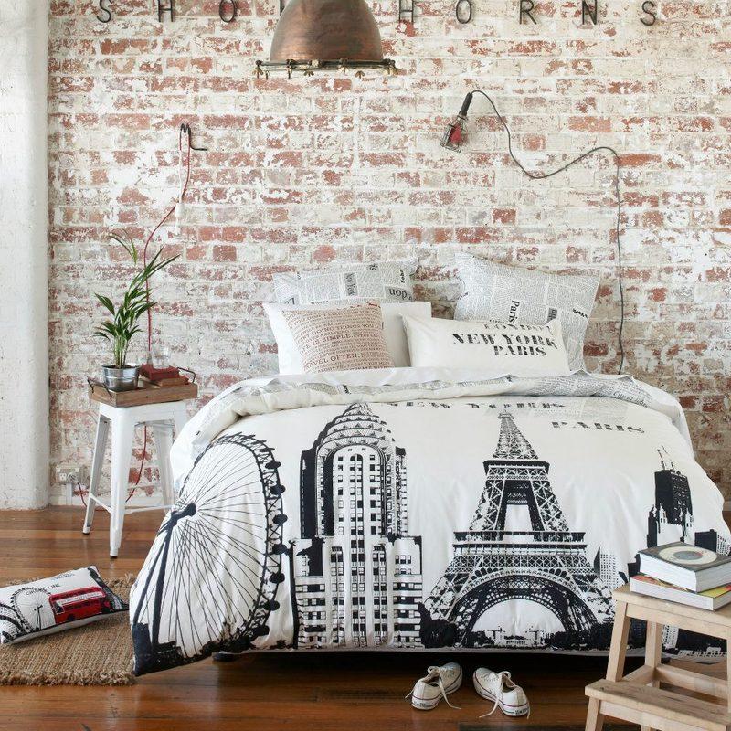 Loft bedroom with brick wallpaper
