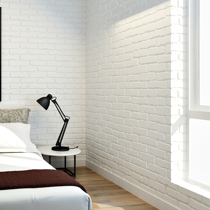 Black table lamp on the bedside table in the bedroom with brick wallpaper