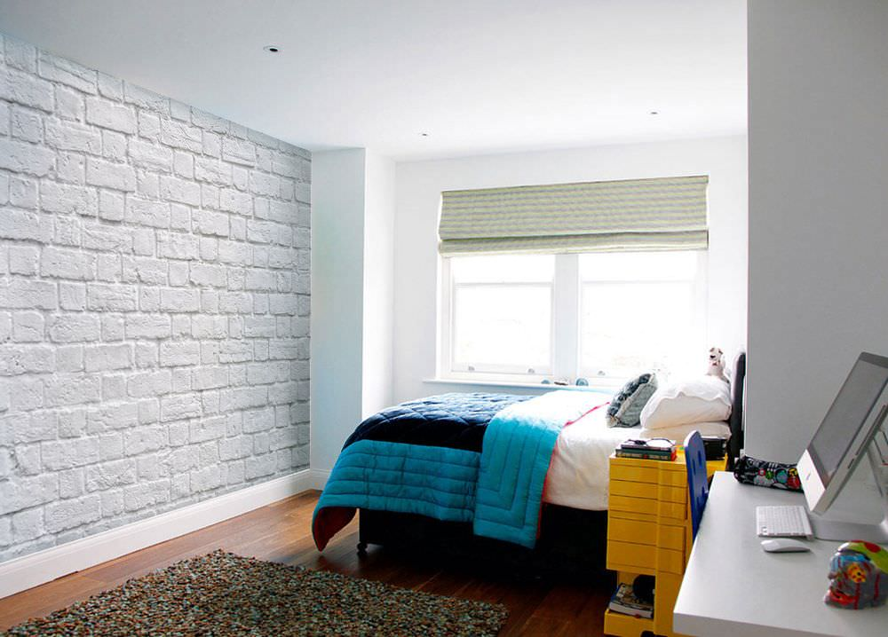 Bright bedspread in a bedroom with white walls