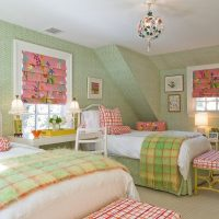 Nursery for a girl with green wallpaper