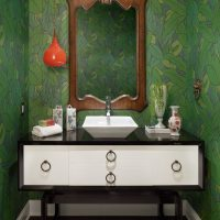 Mirror in a wooden frame above the washbasin