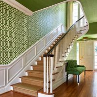 Staircase walls with green wallpaper