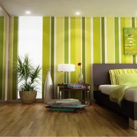 Vertical stripes on the wallpaper in the bedroom