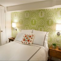 Wall sconces over the head of the bed