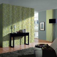 Green wallpaper in the living room with a gray ceiling