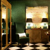 Lighting in a dark room with green wallpaper