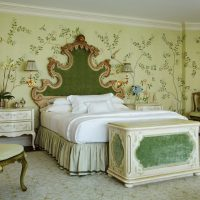 Classic bedroom interior with green wallpaper