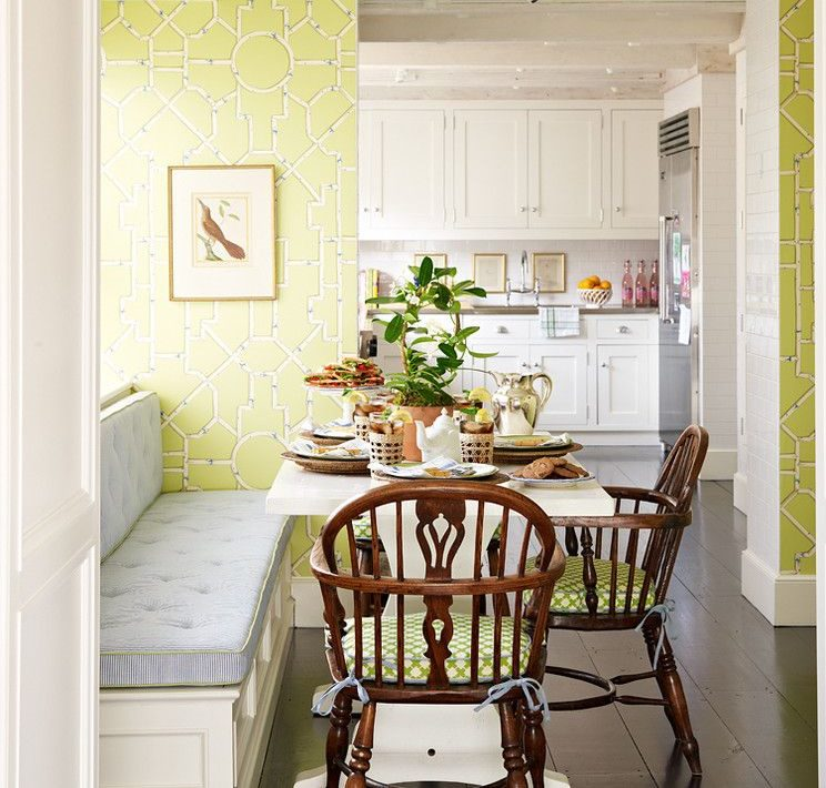 Green wallpaper with geometric patterns on the walls of the kitchen