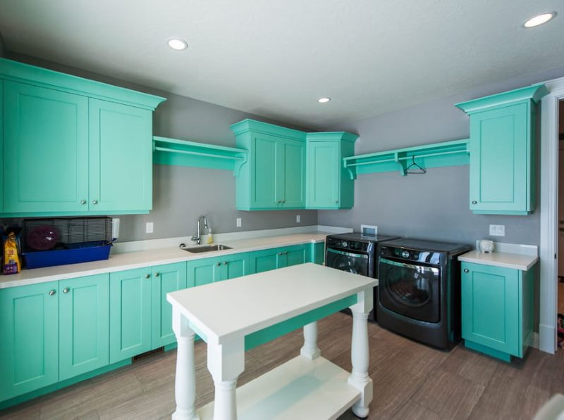 Green cabinets on gray walls